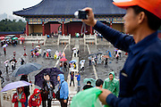 "Visitors and tourist photographing at ""The Temple of Heaven"" which is a complex of Taoist buildings situated in the southeastern part of central Beijing. Beijing is the capital of the People's Republic of China and one of the most populous cities in the world with a population of 19,612,368 as of 2010."