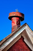 Rustic red chimney with Christmas star