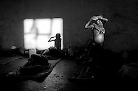 ©ANGOLA 2002. People desperately seeking aid left their villages and gathered at feeding centers. A malnourished child in a therapeutic feeding center set up by MSF in an abandoned factory, Camacupa..Picture featured in book KIDS photos by Markus Marcetic, published 2007.