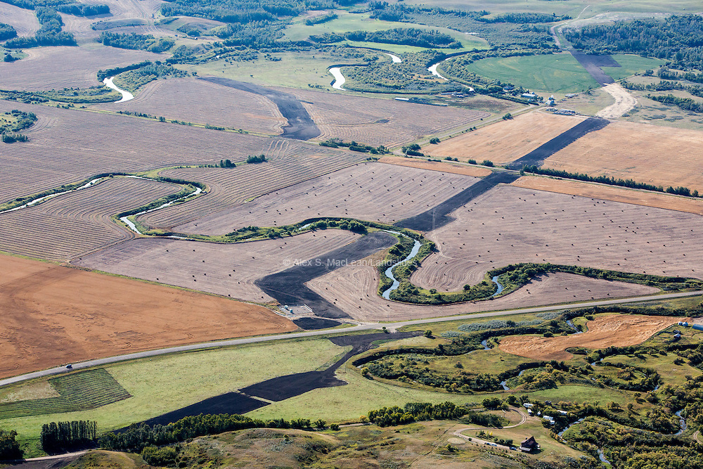 Two pipelines cut through agricutural land and stream. Construction of pipelines across agricultural lands can decrease future yields, mostly due to soil compaction and mixing of topsoil and subsoil in the pipeline's right of way. The pipeline's stream crossing also pose a risk to the local watershed if a rupture or leak were to occur.