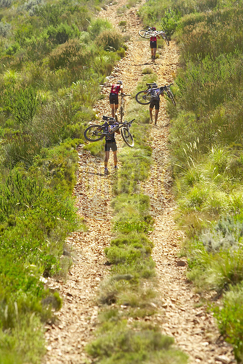 WESTERN CAPE, SOUTH AFRICA -  30 March 2008, Oliver Munnik and Erik Kleinhans of Mongoose Red & Aron Viljoen and Marc Bassingthwaite of Garmin / DCM Pro Team climb Gamtaskloof during stage two of the 2008 Absa Cape Epic Mountain Bike stage race from Saasveld Campus Nelson Mandela Metropolitan University in George to Calitzdorp Spa, Calitzdorp in the Western Cape, South Africa..Photo by Gary Perkin/SPORTZPICS