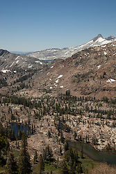 """""""Desolation Wilderness View 1"""" - Photograph from a vista point of the Tahoe Desolation Wilderness. A sliver view of Lake Aloha can be seen in the distance."""