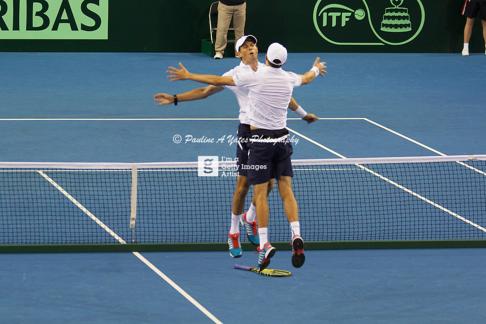 Bryan Brothers celebrate with their trademark chest bump after beating Jamie Murray and Dominic Inglot in the doubles Davis Cup