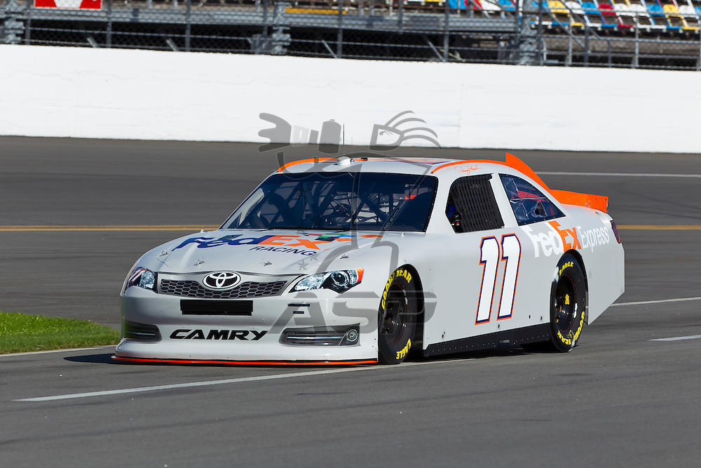 12 January, 2012:   Denny Hamlin (11) brings his FedEx Toyota down the front stretch during open testing for the NASCAR Sprint Cup Series at the Daytona International Speedway in Daytona Beach, FL.