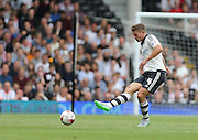 Fulham defender Shaun Hutchinson during the Sky Bet Championship match between Fulham and Brighton and Hove Albion at Craven Cottage, London, England on 15 August 2015.