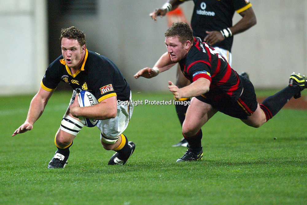 13 August 2004, Westpac Stadium, Wellington, <br /> New Zealand, Rugby Union, NPC Div 1<br /> Wellington Lions vs Canterbury<br /> Lion's Kristian Ormsby goes over for a try while beeing tackled by Canterbury's Chris King during Wellington's 34-22 win over Canterbury on Friday night.<br /> Please Credit: Marty Melville/Photosport