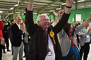 Labour Party supporters cheering victorious candidate Angela Eagle at the count at Bidston Tennis Centre, Wirral for the Wallasey constituency in the 2015 UK General Election. Ms Eagle first won the seat for Labour at the 1992 General Election. Voters across the UK went to the polls to vote to elect 650 constituency MPs.