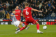 Kieran Gibbs scores a goal to make it 1-0 and West Bromwich Albion celebrate during the EFL Sky Bet Championship match between West Bromwich Albion and Bristol City at The Hawthorns, West Bromwich, England on 27 November 2019.