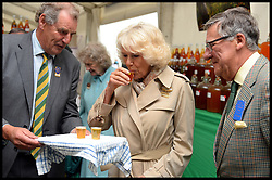 The Duchess of Cornwall judges the cider tasting competition as she  declares Harry's cider (cider on Right) the winner during a tour of the Royal Bath & West Show, Royal Bath & West Showground, Shepton Mallet, Somerset, United Kingdom, Wednesday, 28th May 2014. Picture by Andrew Parsons / i-Images