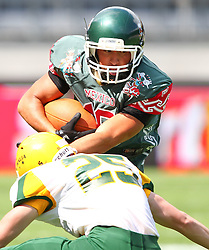 10.07.2011, Tivoli Stadion, Innsbruck, AUT, American Football WM 2011, Group A, Mexico (MEX) vs Australia (AUS), im Bild Arzate Erick  (Mexico, #10, WR) gets a tackle from Chris Pearce (Australia, #25, DB)  // during the American Football World Championship 2011 Group A game, Mexico vs Australia, at Tivoli Stadion, Innsbruck, 2011-07-10, EXPA Pictures © 2011, PhotoCredit: EXPA/ T. Haumer