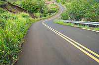 Winding highway 550 on the way up to Waimea Canyon just North of Waimea, Kauai, Hawaii, USA.