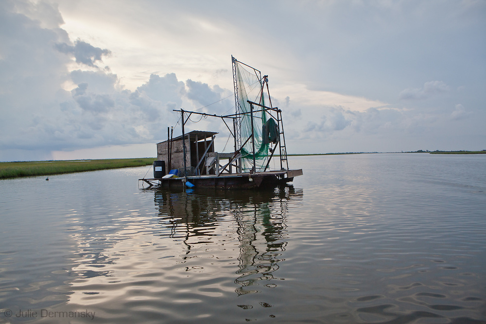 Fishing standg in the marsh between Isle de Jean Charles and Pointe-Aux-Chien in Terribone Parish Louisiana. The Island is under constant threat of flooding due to coastal erosion.