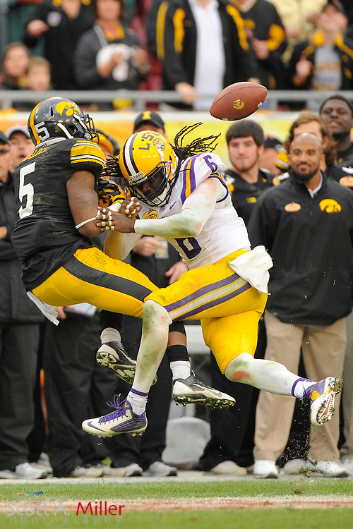 LSU Tigers safety Craig Loston (6) breaks up a pass intended for Iowa Hawkeyes running back Damon Bullock (5) during the LSU Tigers 21-14 win over the Hawkeyes in the 2014 Outback Bowl at Raymond James Stadium on Jan 1, 2014  in Tampa, Florida.            ©2014 Scott A. Miller