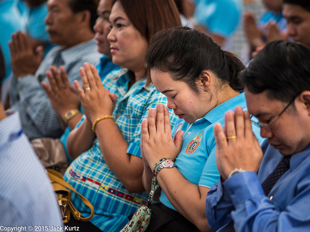 11 AUGUST 2015 - BANGKOK, THAILAND: People pray during a service to honor Queen Sirikit of Thailand before her 83rd birthday. Queen Sirikit was born Mom Rajawongse Sirikit Kitiyakara on August 12, 1932. She is the queen consort of Bhumibol Adulyadej, King (Rama IX) of Thailand. She met Bhumibol in Paris, where her father was the Thai ambassador. They married in 1950, she was appointed Queen Regent in 1956. The King and Queen had one son and three daughters. She has not made any public appearances since her hospitalization in 2012. Her birthday is celebrated as Mother's Day in Thailand, schools and temples across Thailand hold ceremonies to honor the Queen and mothers.      PHOTO BY JACK KURTZ