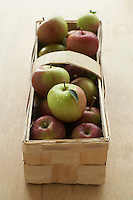 Apples in basket on table elevated view close-up
