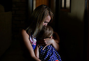 Roxanne Warneke holds her 18 month old daughter, Billie Grace, at their home in Marana, Ariz. on June 28, 2015. Warneke's husband, William, was among the 19 firefighters from the Granite Mountain Hotshots crew that perished while fighting a wildfire in Yarnell, Ariz. on June 30, 2013. (For The New York Times)