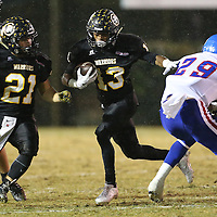 Lauren Wood | Buy at photos.djournal.com<br /> Pontotoc's Darryl Dilworth finds the pocket and rushes past Noxubee County's Antonio McCloud during Friday night's playoff game at Pontotoc.