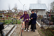 Didima (left), 83 years old and Maria visiting the local cemetary in Marginenii de Jos.