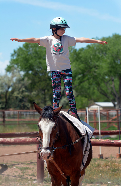 "gbs050717n/LIVING -- Esmeralda  ""Esme""  Marquez-Chavez, 9, performs a horse vaulting freestyle program during practice at Cloud Dancers of the Southwest Therapeutic Horsemanship stables. (Greg Sorber/Albuquerque Journal)"