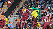 Ben Williams (Bradford) punches the ball just ahead of Barry Hayles (Chesham) during the The FA Cup match between Bradford City and Chesham FC at the Coral Windows Stadium, Bradford, England on 6 December 2015. Photo by Mark P Doherty.