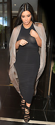 Kim Kardashian West and Kanye West leaving a London hotel, UK. 27/06/2015<br />BYLINE MUST READ : GOTCHAIMAGES.COM<br /><br />Copyright by © Gotcha Images Ltd. All rights reserved.<br />Usage of this image is conditional upon the acceptance <br />of Gotcha Images Ltd, terms and conditions available at<br />www.gotchaimages.com