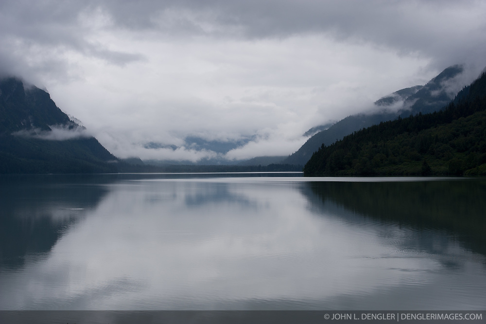 Early morning calm waters of Chilkoot Lake in the Chilkoot Lake State Recreation Site near Haines, Alaska offer quiet reflection.