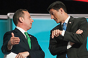 July 19, 2016 - Cleveland, Ohio: Convention Chair Paul Ryan and Republican National Committee Chairman Reince Priebus talk on stage after the Alaska delegation protested how their votes were counted.
