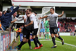Andrew Hughes of Peterborough United is mobbed by team-mates after scoring the opening goal of the game - Mandatory by-line: Joe Dent/JMP - 21/10/2017 - FOOTBALL - Glanford Park - Scunthorpe, England - Scunthorpe United v Peterborough United - Sky Bet League One