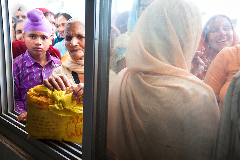 Sikh believers waiting in line to enter the dinning hall of the Langar. Some Langars serve tens of thousand free meals per day.