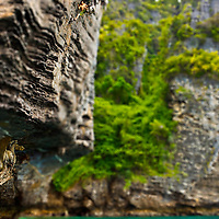 "Greg Sun on stalactite, ""deep water soloing"" without rope, Poda Island, Krabi, Thailand"