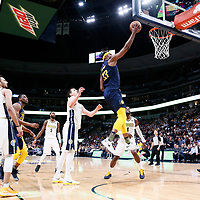03 April 2018: Indiana Pacers center Myles Turner (33) goes for the layup past Denver Nuggets forward Paul Millsap (4) and Denver Nuggets center Nikola Jokic (15) during the Denver Nuggets 107-104 victory over the Indiana Pacers, at the Pepsi Center, Denver, Colorado, USA.