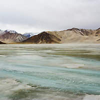 Frozen lake and White Sand Hill, Tashkurgan County, Xinjiang, China