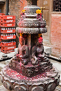 "Buddhist artwork is carved into an altar in Kathmandu, Nepal, Asia. Kathmandu, the largest city in Nepal (700,000 people), is sometimes called ""Kantipur"". The oldest firmly dated building in the earthquake-prone Kathmandu Valley is almost 1,992 years old. Kathmandu is named after a structure in Durbar Square called Kaasthamandap (or Maru Satal), built in 1596 AD by King Laxmi Narsingh Malla. In Sanskrit, Kaasth = ""wood"" and Mandap = ""covered shelter."" The original inhabitants are Newars, who speak the language Nepal Bhasa. However, Nepali is the lingua franca of the valley and is the most widely spoken language. The city stands at an elevation of 6235 feet / 2230 meters."