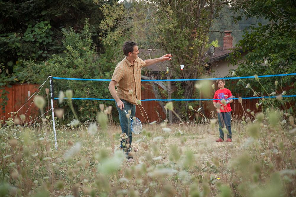 Neighbors Peter and Leonardo play badmitten on School Street in Calistoga
