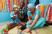209, Frederic Jean-Jacques, Male, 12 years old, UCL, Before, with Child Life Specialist Observor Bruce Bradfield from South Africa in child life.<br /> <br /> Hospital Joseph Ravoahangy Andrianavalona.  Operation Smile's 2015 mission to Antananarivo - Madagascar. 10th -18th April 2015.<br /> <br /> (Operation Smile Photo - Zute Lightfoot)