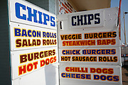 Chips and snack food board menu at seaside cafe Great Yarmouth England
