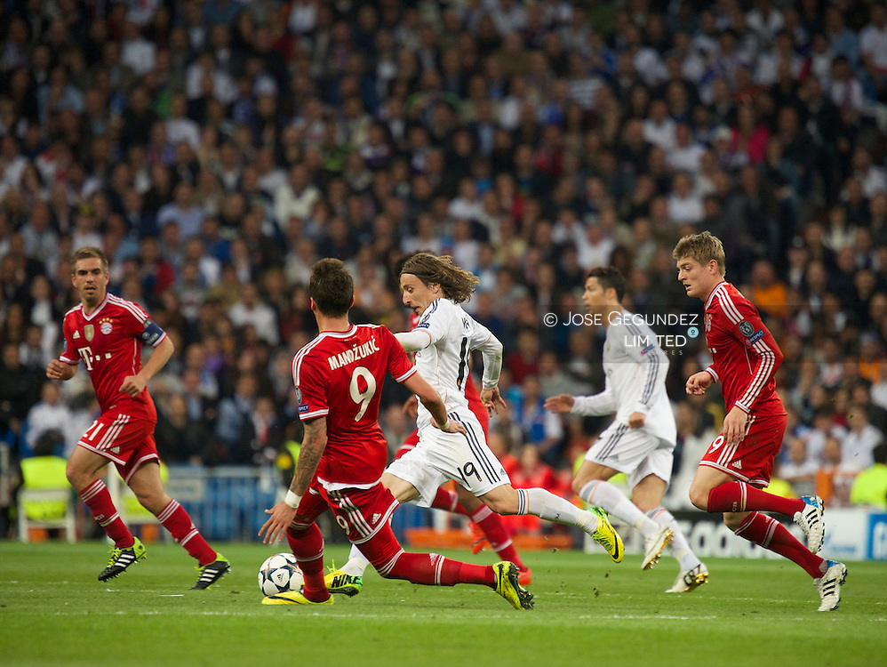 Modric in action during the UEFA Champions League semi final match between Real Madrid and Bayern Munich at Santiago Bernabeu stadium on April 23, 2014 in Madrid, Spain