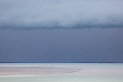 A pair of pearling boat wait out storms as they roll in over Roebuck Bay in the Kimberley wet season.