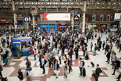 © Licensed to London News Pictures. 10/08/2016. London, UK. Commuters wait for Southern Rail services in Victoria Station, London. Southern Rail staff have called off the final two days of a week-long strike over job losses and passenger safety. Photo credit: Rob Pinney/LNP