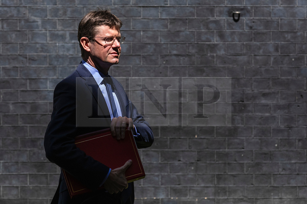 © Licensed to London News Pictures. 21/05/2019. London, UK. Secretary of State for Business, Energy and Industrial Strategy Greg Clark leaves 10 Downing Street after the Cabinet meeting. Prime Minister Theresa May is expected to make a statement to Paliament outlining changes to the Withdrawal Agreement Bill before it is brought back before Parliament. Photo credit: Rob Pinney/LNP