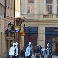 EN&gt; A group of music students in Prague's Old Town Square on their way to school | <br />