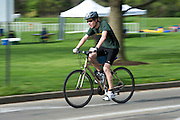 Ronald Butterbaugh bikes during the O'Bleness Race for a Reason Triathlon Saturday, April 27, 2013. The triathlon included a 500mm Serpentine Swim at the Ohio University Aquatic Center, a 15 mile bike ride to the Plains and back and then a 5k run that finished at Tailgreat Park across from Peden Stadium. Race for a Reason, Race 4 A Reason, Annual Events, Events, Students, Faculty & Staff