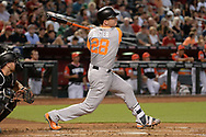 PHOENIX, AZ - AUGUST 26:  Buster Posey #28 of the San Francisco Giants wearing a nickname-bearing jersey swings at a pitch in the game against the Arizona Diamondbacks at Chase Field on August 26, 2017 in Phoenix, Arizona.  (Photo by Jennifer Stewart/Getty Images)