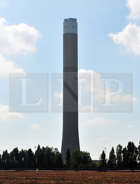 © Licensed to London News Pictures. 07/09/2016<br /> Frame 1<br /> Grain Power Station chimney demolition in Kent.<br /> <br /> One of the country's tallest structures has been demolished this morning at 11am.<br />  The Power Station chimney is 244m (801 ft) which makes it taller than Canary Wharf in London. <br /> <br />  The demolition is a British record for the tallest concrete structure to be blown up!<br /> <br /> <br /> <br /> (Byline:Grant Falvey/LNP)