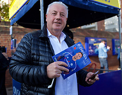 LONDON, ENGLAND - Saturday, October 31, 2015: A Chelsea supporter with the match-day programme before the Premier League match against Liverpool at Stamford Bridge. (Pic by Lexie Lin/Propaganda)