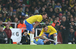 Uruguay's Luis Suarez (centre) on the ground after picking up an injury during the International Friendly match at the Emirates Stadium, London.