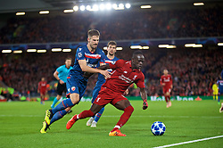 LIVERPOOL, ENGLAND - Wednesday, October 24, 2018: Liverpool's Sadio Mane is pushed over by FK Crvena zvezda Miloš Degenek, but no penalty is awarded, during the UEFA Champions League Group C match between Liverpool FC and FK Crvena zvezda (Red Star Belgrade) at Anfield. (Pic by David Rawcliffe/Propaganda)