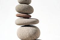 Balancing stones. Minimalism decor photography. White and nuetral tones.