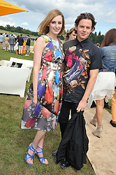 LAURA CARMICHAEL and CHRISTOPHER KANE at the 2012 Veuve Clicquot Gold Cup Final at Cowdray Park, Midhurst, West Sussex on 15th July 2012.