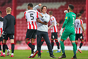 Brentford Head Coach Thomas Frank points to Brentford defender Ethan Pinnock (5) and celebrates at full time during the EFL Sky Bet Championship match between Brentford and Charlton Athletic at Griffin Park, London, England on 7 July 2020.